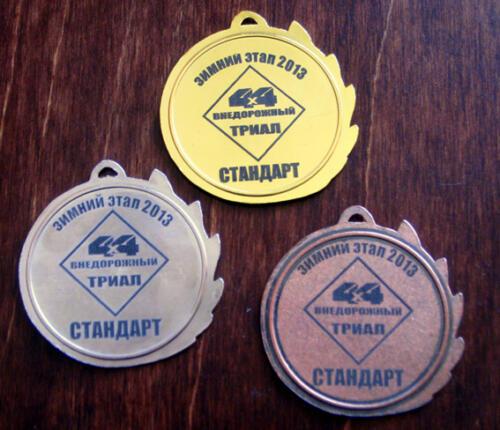 Лазерная гравировка металлических медалей